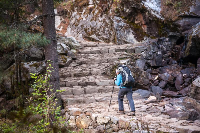 Trekker in Khumbu valley on a way to Everest Base camp stock image