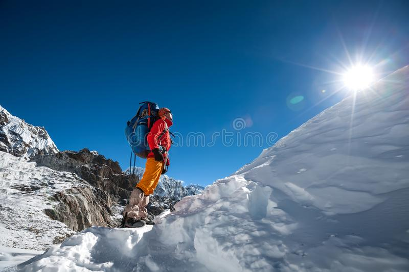 Trekker looks at the sun while crossing Cho La pass in Everest r. Egion. Nepal stock photos
