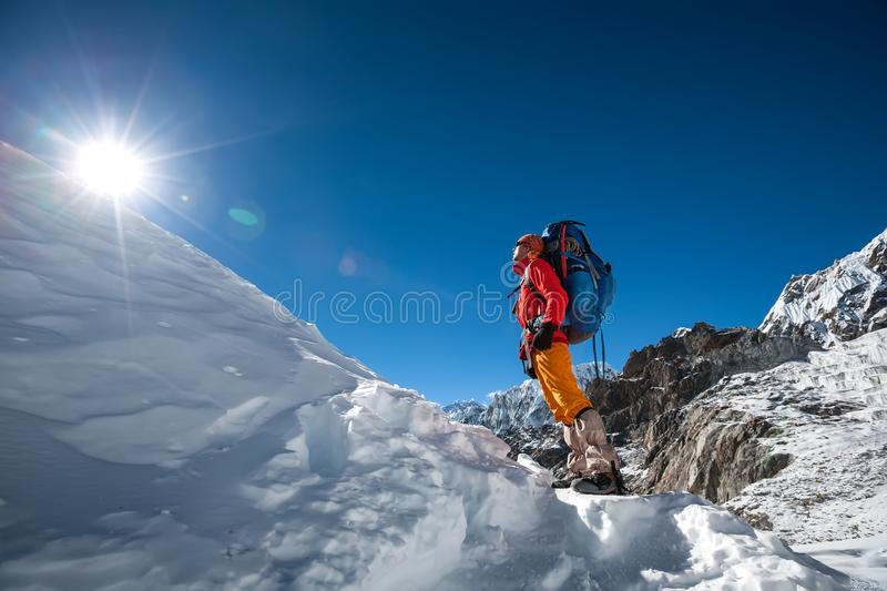 Trekker looks at the sun while crossing Cho La pass in Everest r. Egion, Nepal royalty free stock photos