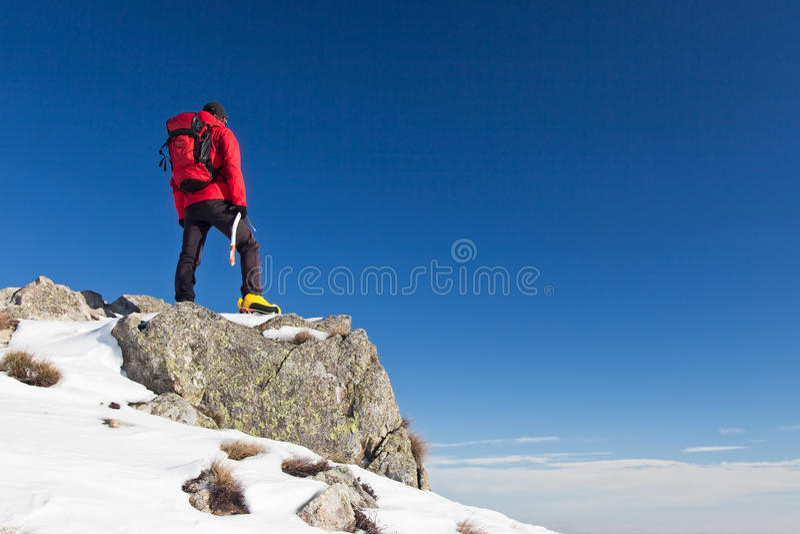 Trekker observes the horizon royalty free stock photos