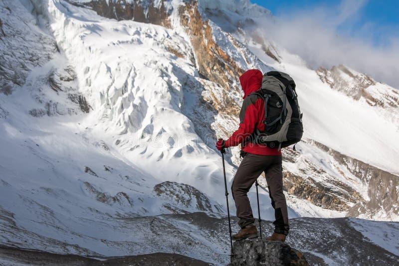 Trekker at the Thorung La pass - highesr point of Annapurna circuit in Nepal.  royalty free stock photos