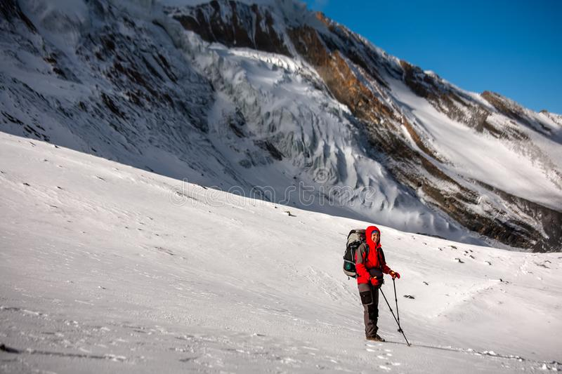 Trekker at the Thorung La pass - highesr point of Annapurna circuit in Nepal.  royalty free stock photography