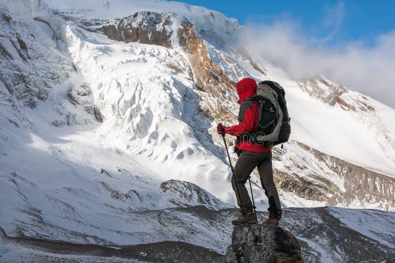 Trekker at the Thorung La pass - highesr point of Annapurna circuit in Nepal.  royalty free stock image