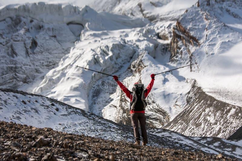 Trekker at the Thorung La pass - highesr point of Annapurna circuit in Nepal.  stock photo