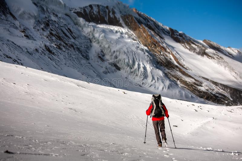 Trekker at the Thorung La pass - highesr point of Annapurna circuit in Nepal.  stock image