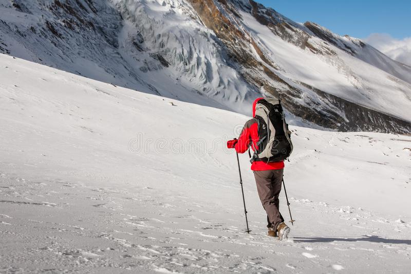 Trekker at the Thorung La pass - highesr point of Annapurna circuit in Nepal.  stock photography