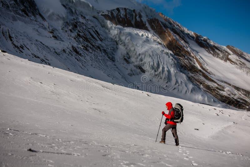 Trekker at the Thorung La pass - highesr point of Annapurna circuit in Nepal.  stock photos