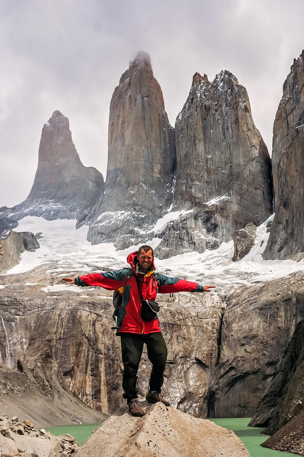 Trekker at Torres Del Paine. Man standing on the rock in front of the stunning Torres del Paine peaks, Patagonia, southern Chile, South America royalty free stock photography