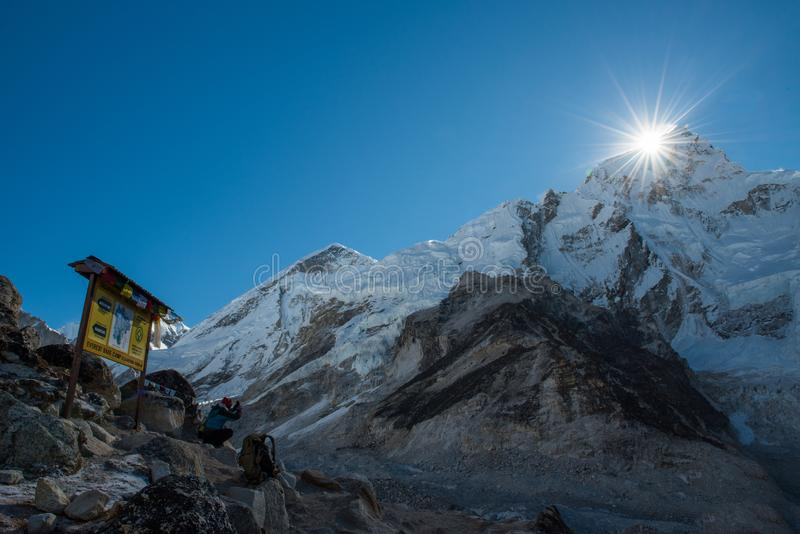 trekker use smart mobile phone taking photo of everest mountain royalty free stock photo