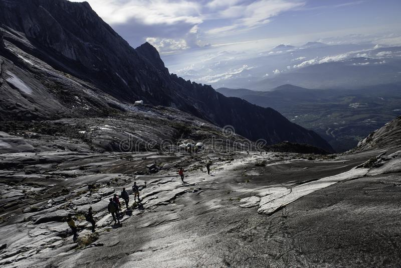 Trekker walk down from Kinabalu mountain after submit at low peak ,Malaysia.  stock photography