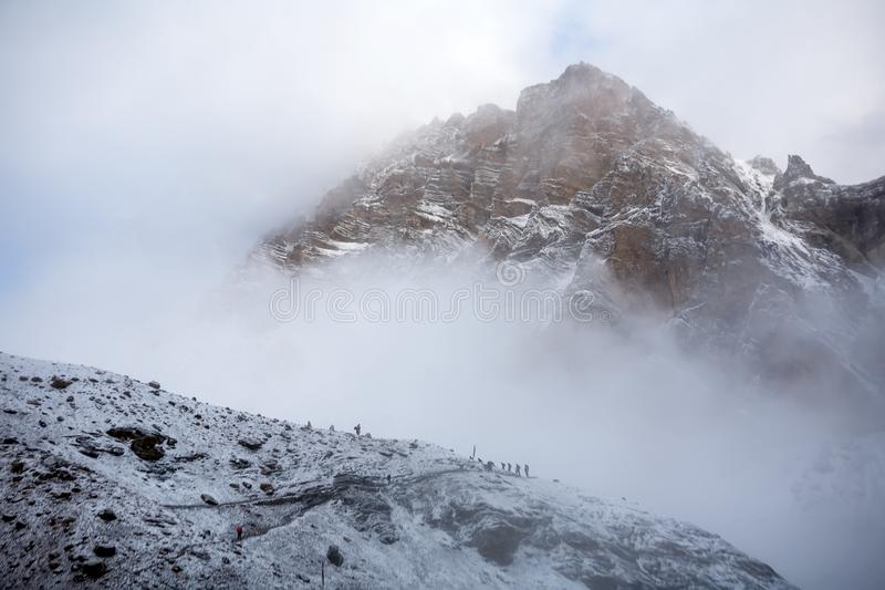 Trekkers approaching Thorung La pass - the highest on Annapurna. Circuit in Nepal royalty free stock images