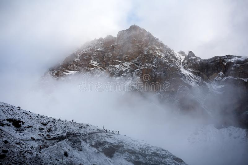 Trekkers approaching Thorung La pass - the highest on Annapurna. Circuit in Nepal stock photos
