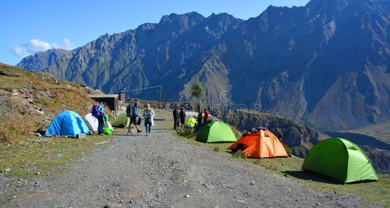 Trekkers tents in bottom of the Kazbek mountain royalty free stock image