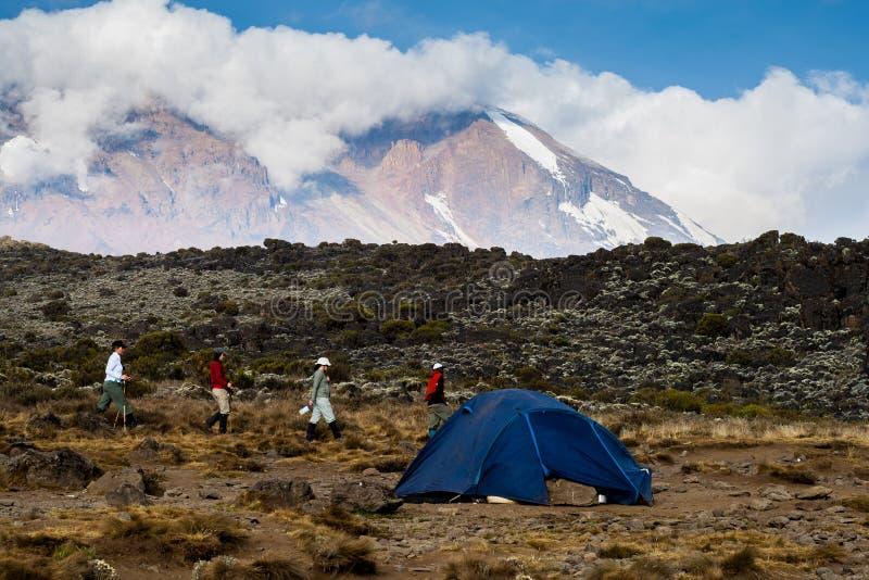 Trekkers walking near camp on Mount Kilimanjaro stock photo
