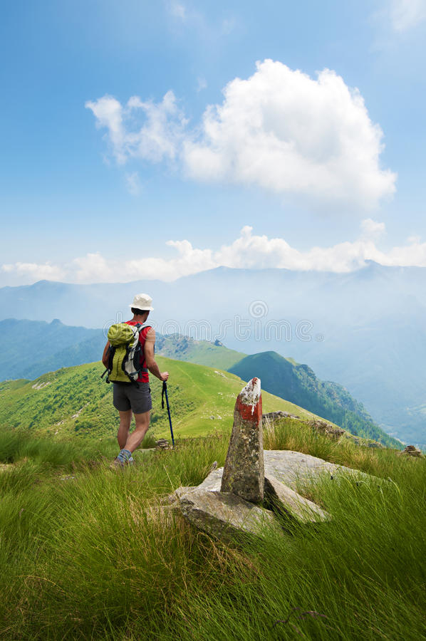 Trekking in the Alps. Man trekking in the Alps in a beautiful sunny day royalty free stock photo