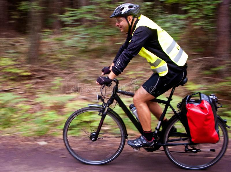 Trekking cyclist. A trekking cyclist on the road stock photos