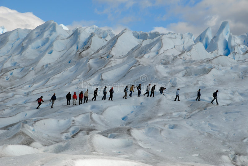 Trekking on a glacier royalty free stock photography