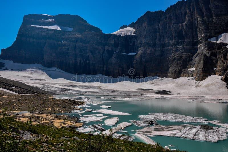 Trekking i Grinnel sjöslinga, glaciärnationalpark, Montana, royaltyfria bilder