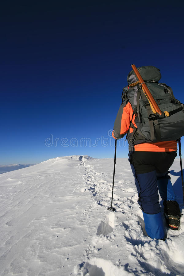 Trekking man in winter royalty free stock photography