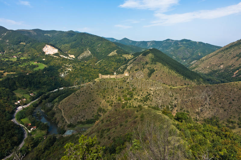 Trekking on mountain Stolovi with medieval serbian fortress Maglic and river Ibar gorge in background royalty free stock photography