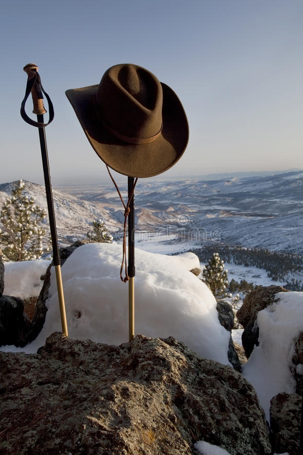 Download Trekking Poles And Hat In Mountain Scenery Stock Image - Image: 13523221