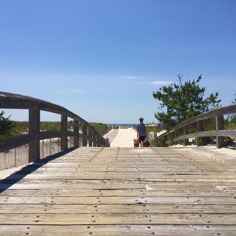 Trekking to the Beach in Summer royalty free stock photos