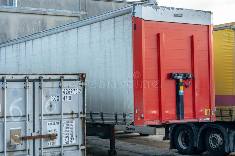 Trelleborg, sweden, 25.12.2018: cargo container and truck trailer parked royalty free stock photography