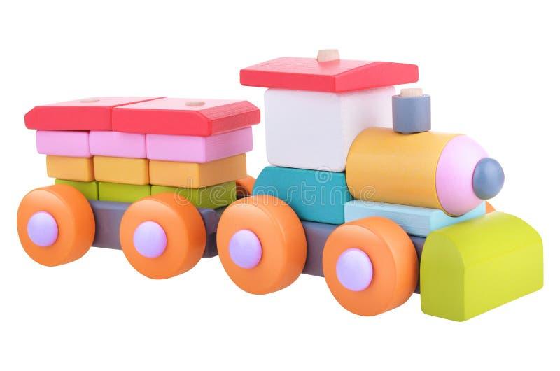 Trem de madeira da lógica do brinquedo com trajeto de grampeamento fotografia de stock royalty free