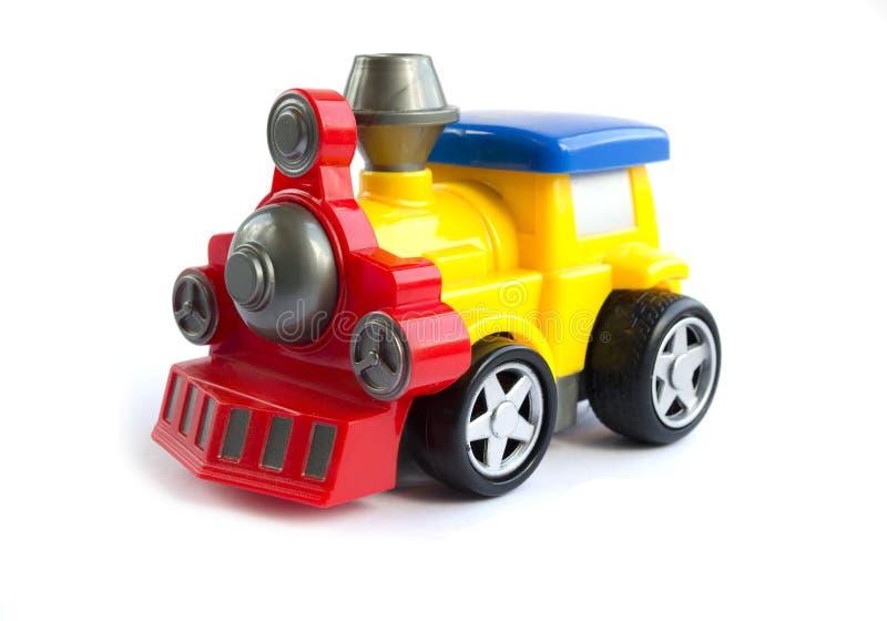 Trem do brinquedo do Pewter com letras Brinquedo do ` s das crian?as amarelo pl?stico com vermelho o trem com um telhado azul imagem de stock royalty free