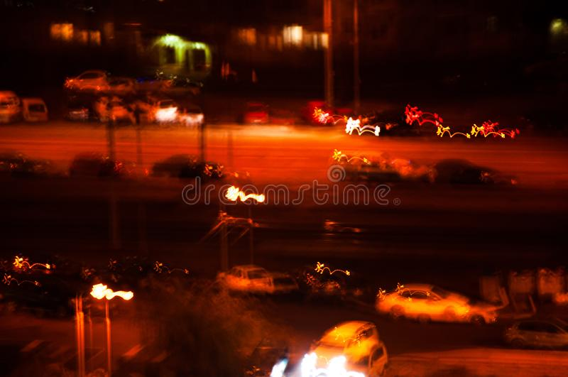 A trembling photo of a night city road. The effect of a drunk stock photo
