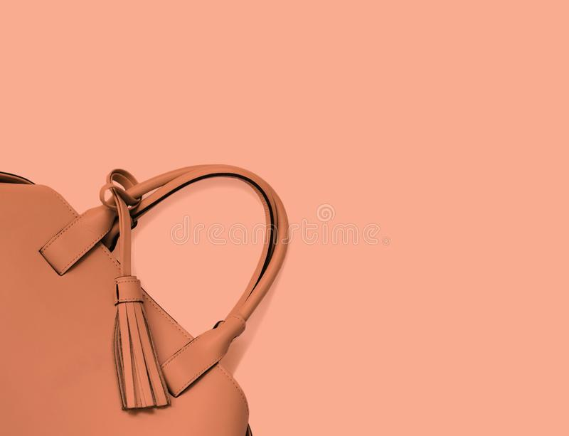 Trend photography on the theme of the new color of the year 2019 - Living Coral. Woman`s handbag background stock photo