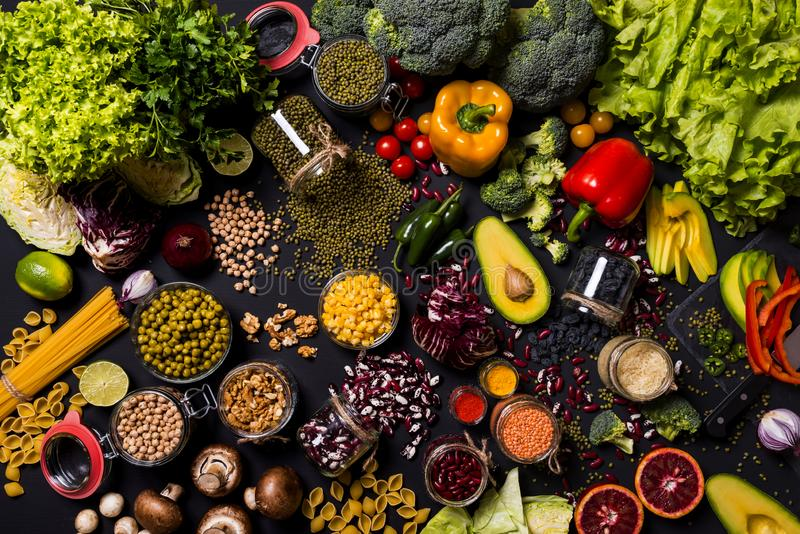 Trend set of fresh vegetables and fruits on black background. Different colorful fresh vegan food. Flat lay. Trend vegetables and fruits on black background stock image