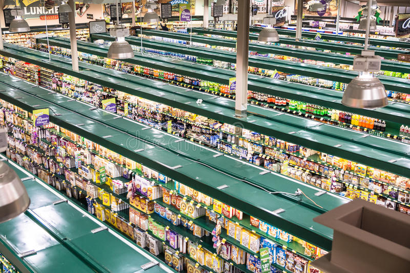 Trend-Setting, Grocery Store. Falls Church, VA, USA - October 25, 2015: An unusual high vantage point provides an overview of a modern, tw0-story grocery store stock image