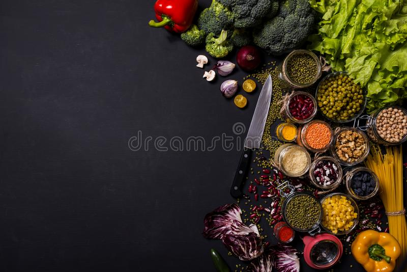 Trend set of fresh vegetables and fruits on black background. Different colorful fresh vegan food. Flat lay. Space for. Trend vegetables and fruits on black royalty free stock photography