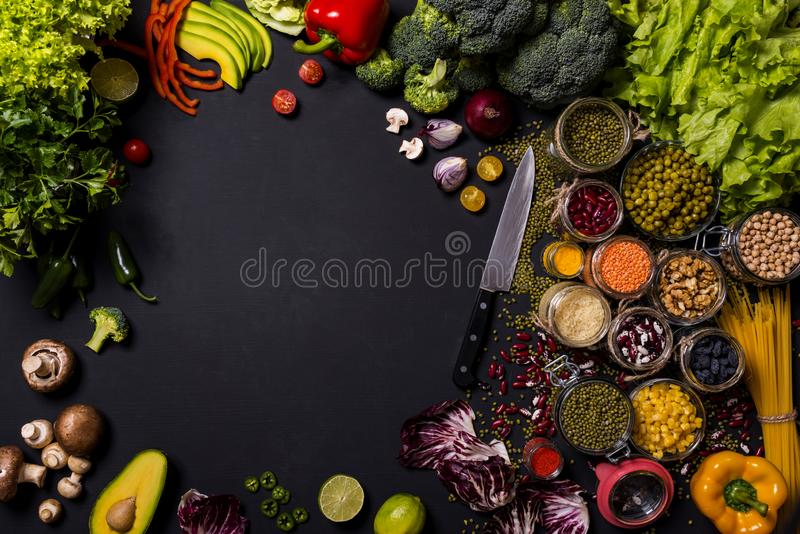 Trend set of fresh vegetables and fruits on black background. Different colorful fresh vegan food. Flat lay. Space for. Trend vegetables and fruits on black stock photos