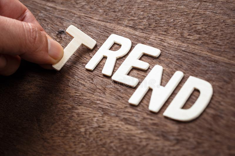 Trend Wood Letters. Hand arrange wood letters as TREND word stock photography