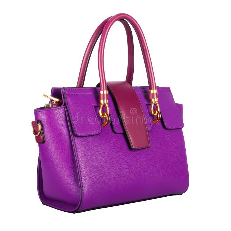 Trendiga purpurfärgade klassiska kvinnors påse med den burgundy klaffen arkivbild