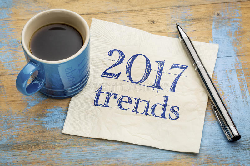 2017 trends concept on napkin with coffee stock images