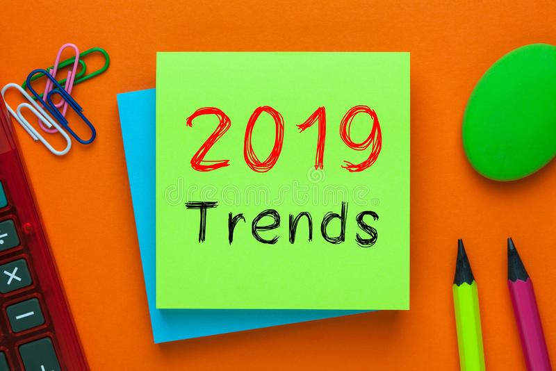 2019 Trends Concept. 2019 Trends written on green note with pencil and calculator a side. Business Concept royalty free stock photos