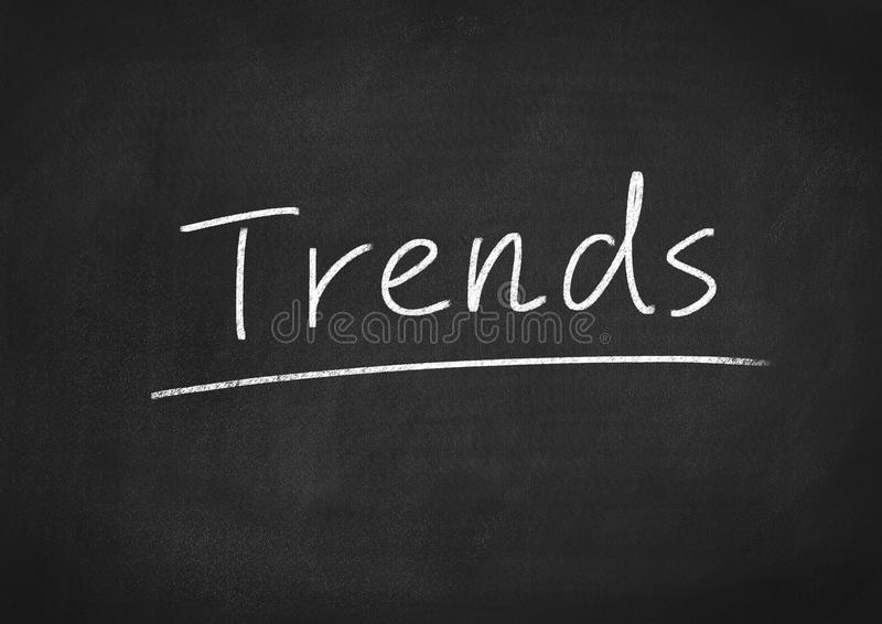 Trends concept. Word on blackboard background stock photography