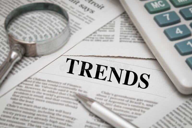 Trends headline. On newspaper background stock image