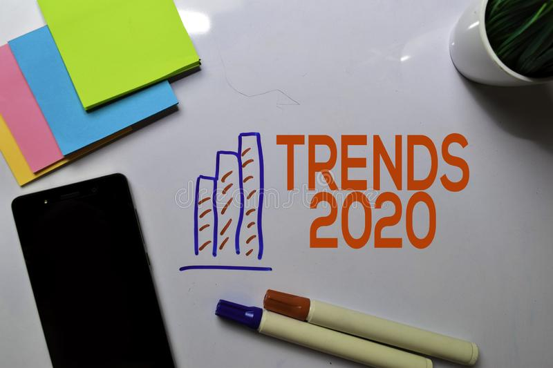 Trends 2020 Text on white board with chart,phone and sticky note royalty free stock images
