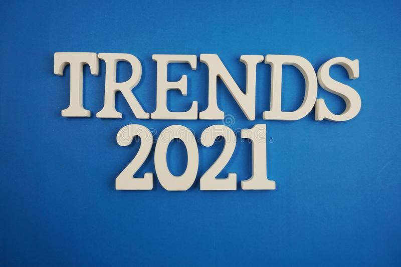 Trends 2021 word alphabet letters on blue background stock photos