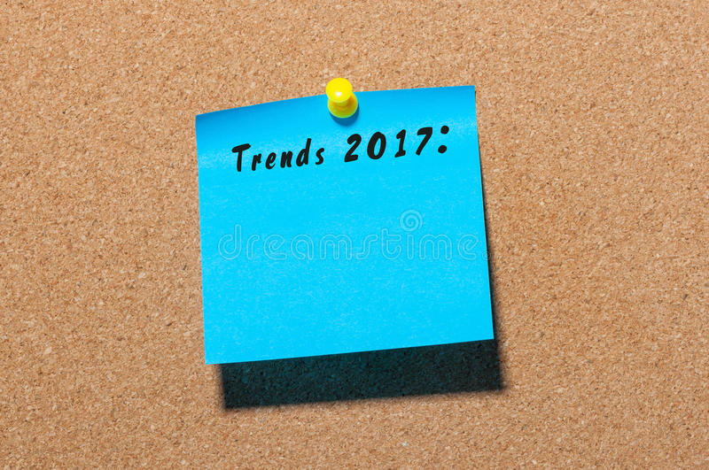 Trends 2017 written on blue sticker pinned at notice board. New year business and fashion innovation. Trends 2017 written at blue sticker pinned at notice board stock photos