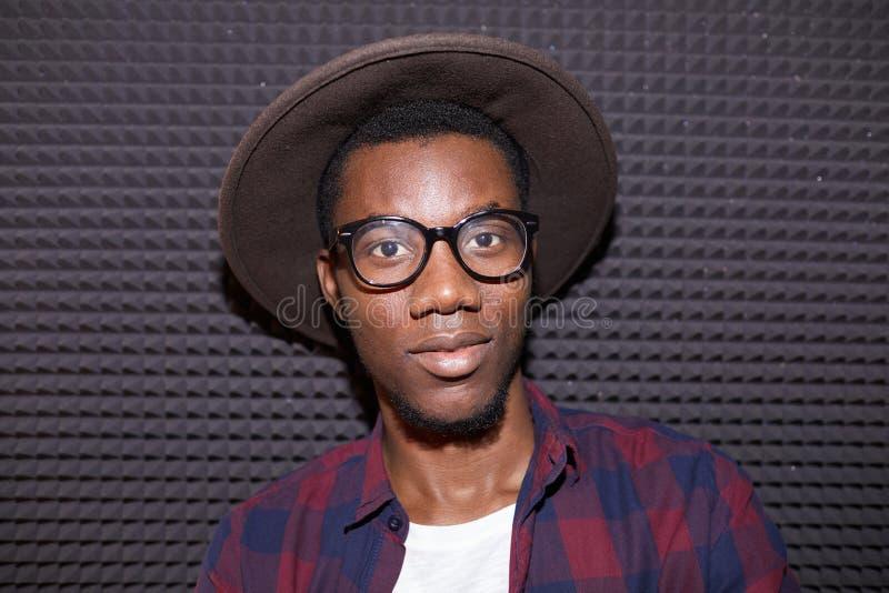 Trendy African Man Posing i NightClub arkivfoton
