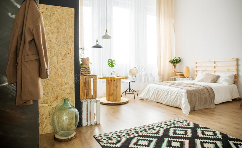 Trendy bedroom with natural details stock photography