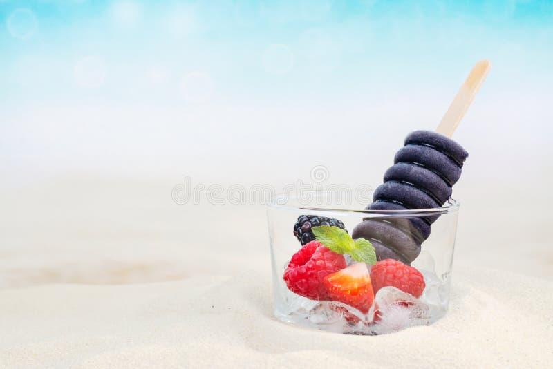 Trendy black charcoal ice cream popsicles stock photos