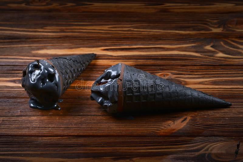 black ice cream in traditional portioned ice cream cones. royalty free stock images