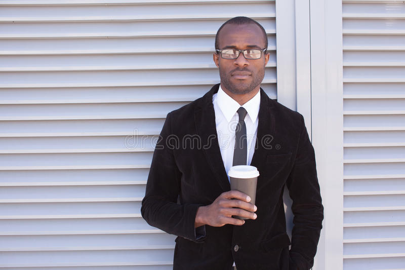 Trendy black man have coffee break stock images