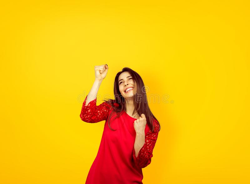 Excited girl raising hands in success stock photography
